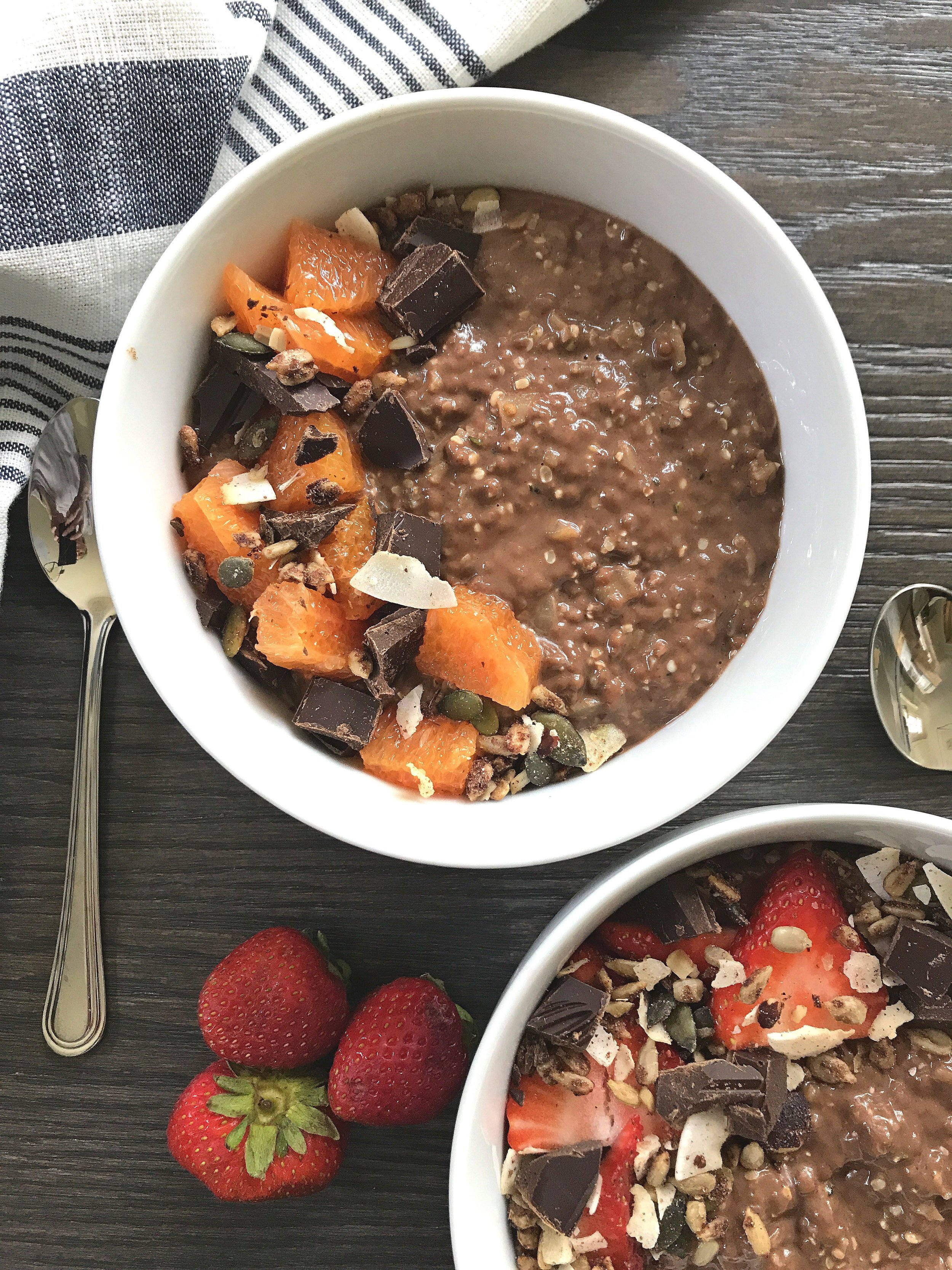 """Chocolate """"Risotto"""" without tiger nuts, topped with grain-free low-carb muesli, diced dark chocolate, Cara Cara orange, and strawberries."""