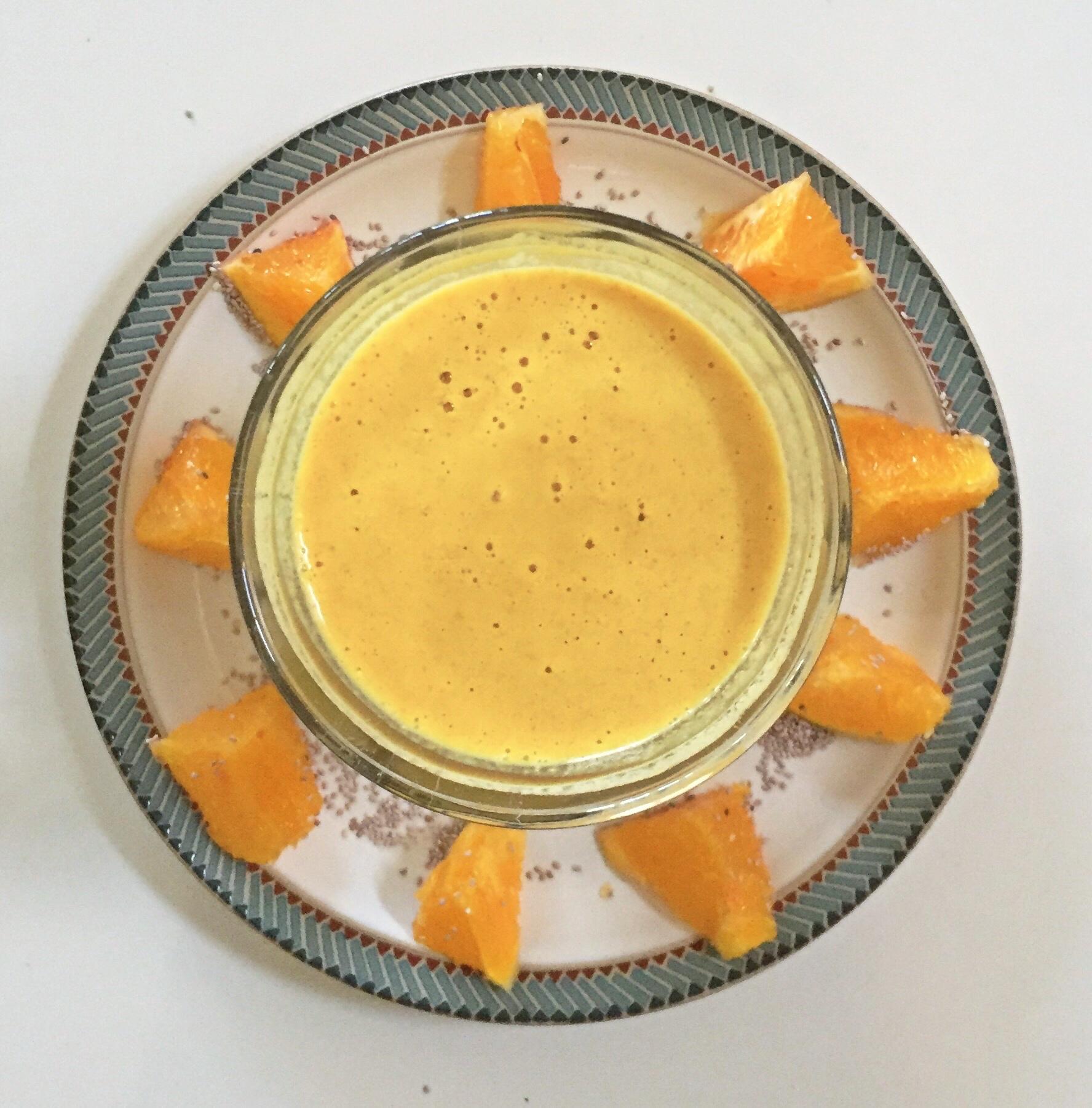 Orange Creamsicle using fresh oranges, banana, coconut kefir, collagen and cashew butter.