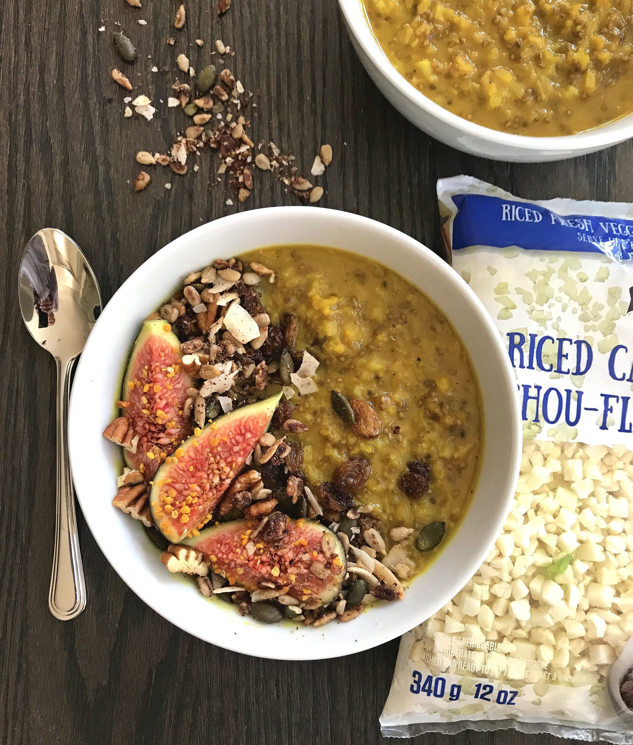 """Golden """"Rice"""" Pudding topped with fresh figs, grain-free muesli, chopped pecans, raisins, and bee pollen."""