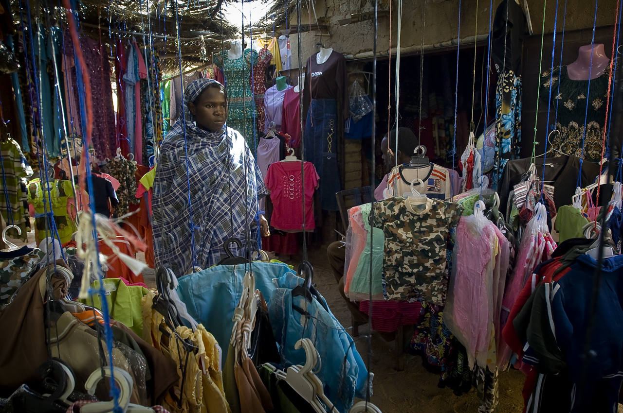 In the market of Gaga camp, a refugee passes by a clothes shop. Gaga camp (21 276 refugees on 30 september 2011). The camp located 71 kilometers from the sudanese border was opened in may 2005.