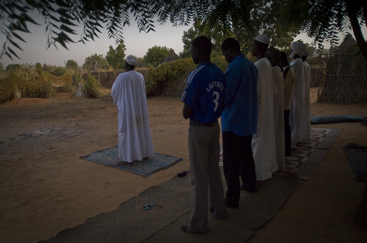 Daoud Abderassoul, an Umda (a traditionnal leader) of the refugees leads the maghrib (sunset prayer) in a mosk in the camp, a delimited compound. The worshipers are praying on mats under a tree. The main tribes in the camp are the Massalite and the Dadjo. the minority are Fur, Taman and Zaghawa. Created on 4 june 2004, Djabal camp sheltered 17.766 persons and 4.681 families in december 2011. It is located 4 kilometers west from Goz Beida, 217 kilometers south from Abeche, 900 kilometers east from N'Djamena the capital and 80 kilometers from the sudanese border.