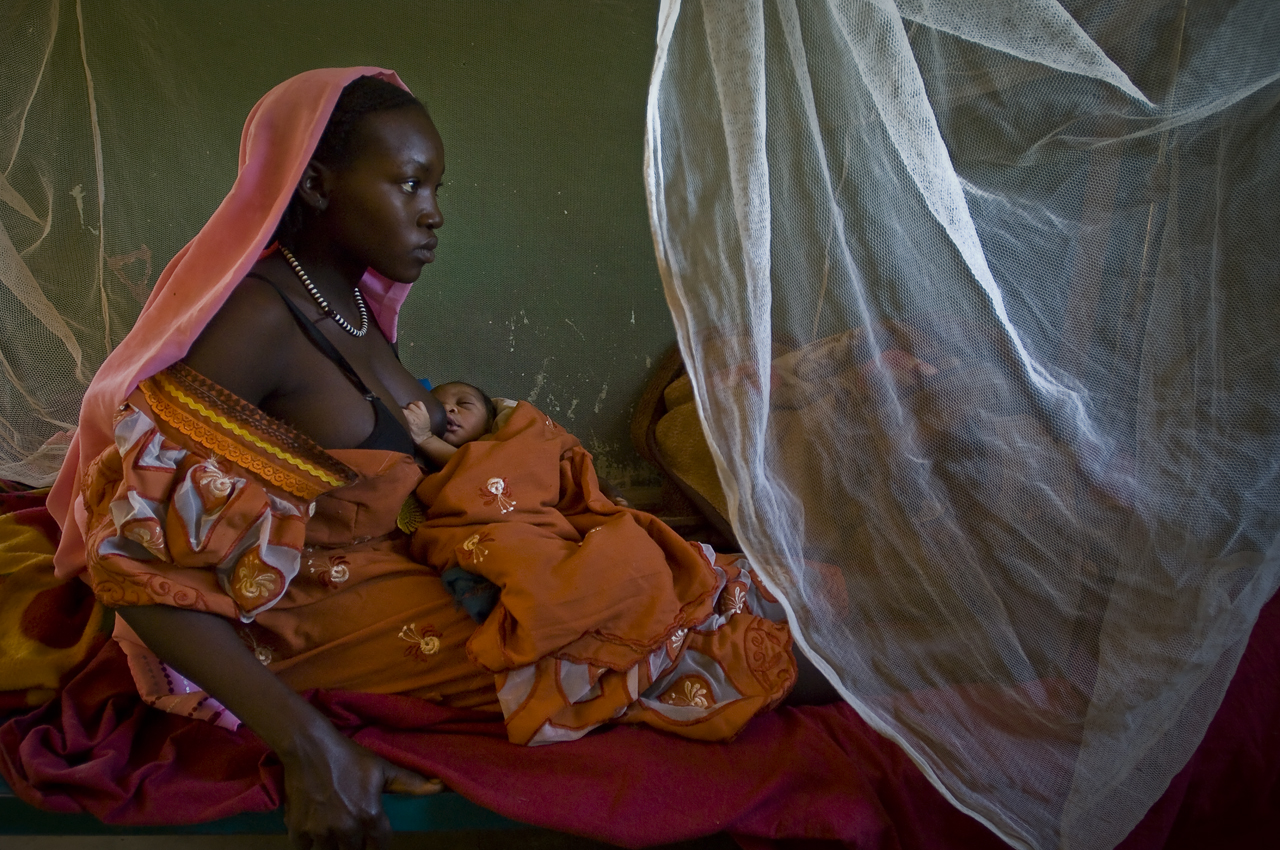 In a ward of the maternity of the Health Center of Djabal camp, a young mother who delivered fews hours ago breast feeds her child. The UNHCR prevision in term of births in Djabal is 80 per week. In fact, the figures are going from 86 to almost 100. Every year from 4472 to 5200 refugees are born only in Djabal camp. Created on 4 june 2004, Djabal camp sheltered 17.766 persons and 4.681 families in december 2011. It is located 4 kilometers west from Goz Beida, 217 kilometers south from Abeche, 900 kilometers east from N'Djamena the capital and 80 kilometers from the sudanese border.