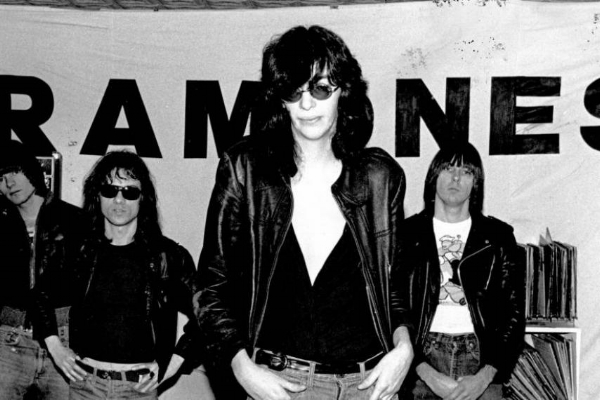 Lofty ambitions: Ramones pose in front of their no-nonsense, Vega-designed banner.