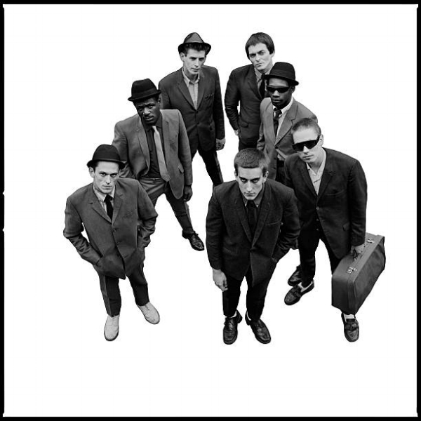 Well suited: cover image from The Specials' eponymous first LP, with Horace Panter in his £7.50 suit (front left) and Jerry Dammers packed and ready to travel (front right). Photo: Chalkie Davies.
