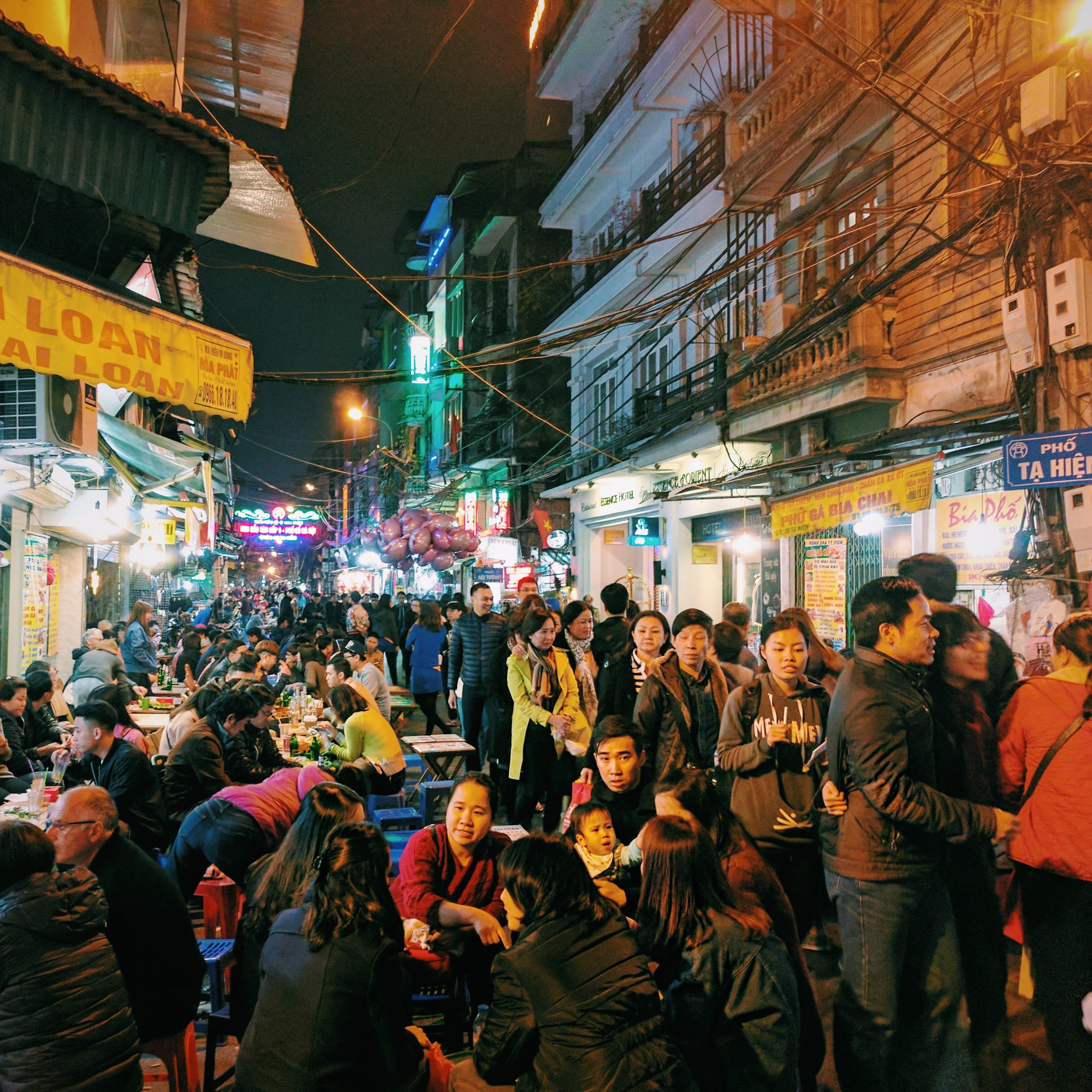 Hanoi nightlife: Plastic stools, fresh beer, and dubious motorbike parking.