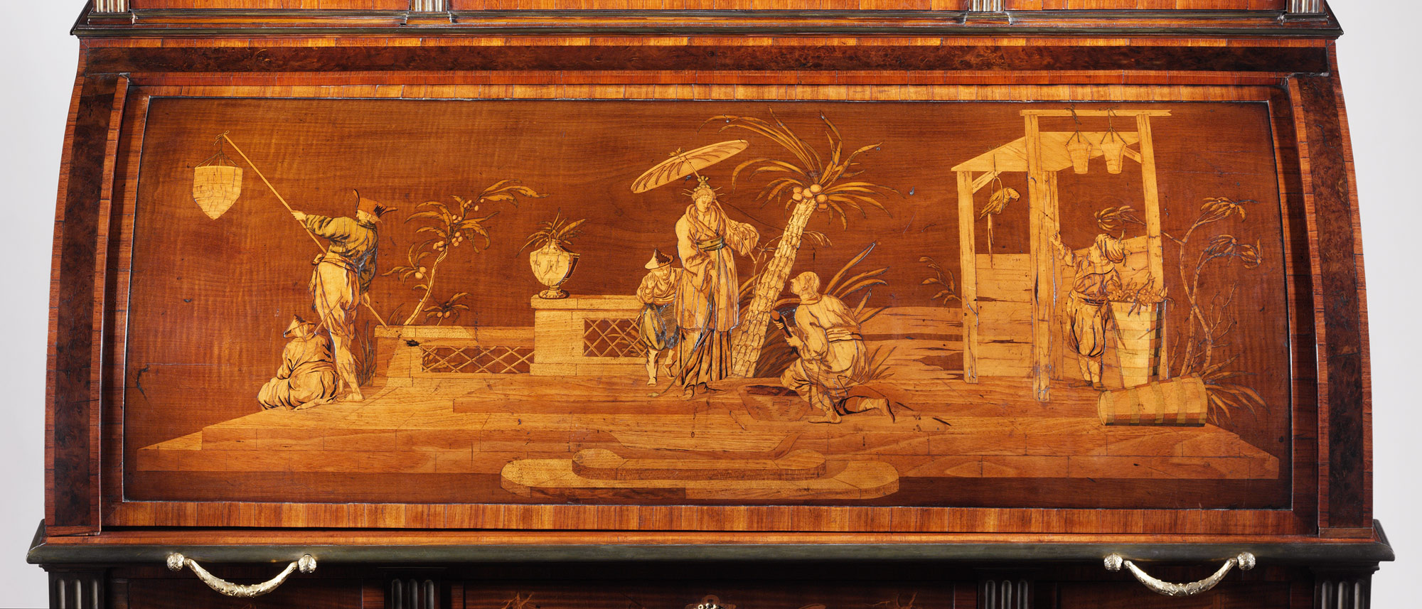 A detail of a marquetry panel on a Roentgen cylinder desk in the collection of the Metropolitan Museum of Art. Marquetry by Johann Michael Rummer.