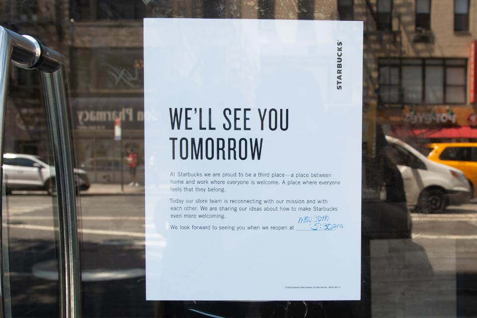 A sign in the window reports that Starbucks or store shut down for a racial predisposition preparation on May 29, 2018, in New York. - Starbucks is shutting in excess of 8,000 stores over the United States Tuesday to lead worker preparing on racial predisposition, a nearly watched practice that spotlights waiting issues of segregation across the country. (Photograph by Bryan R. Smith/AFP/Getty Images)