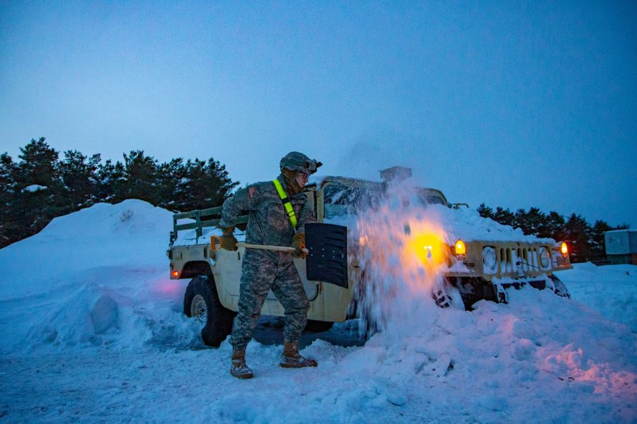 A Mountain Soldier digging his vehicle out of the snow amidst the 1st Polar Vortex of 2019. MICHAEL REINSCH/U.S. ARMY
