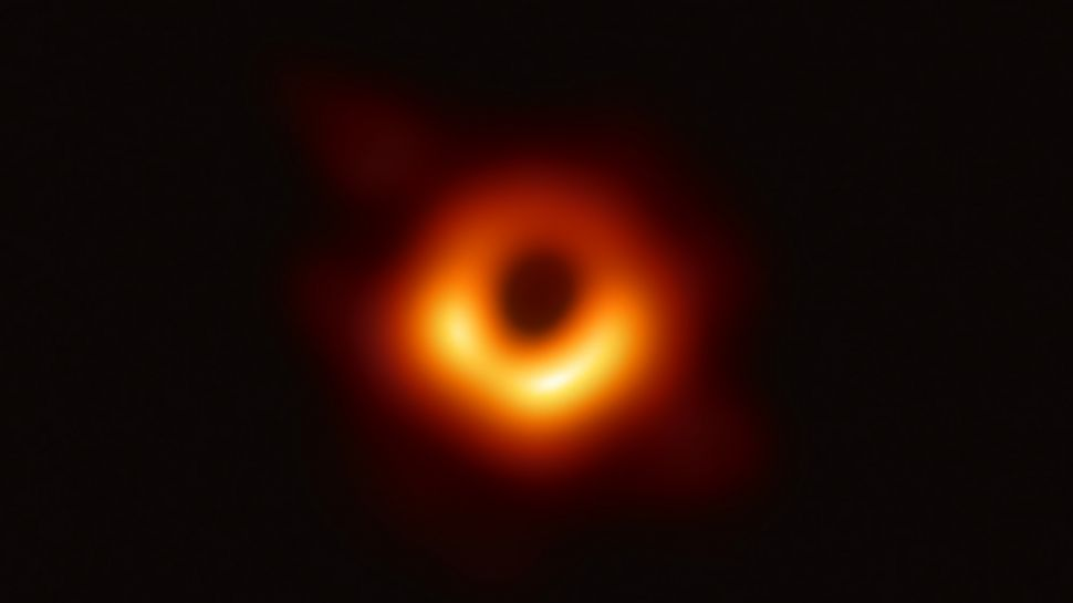 The Event Horizon Telescope, a planet-scale cluster of eight ground-based radio telescopes manufactured through global coordinated effort, caught this picture of the supermassive dark hole in the focal point of the universe M87 and its shadow. (Image: © EHT Collaboration)