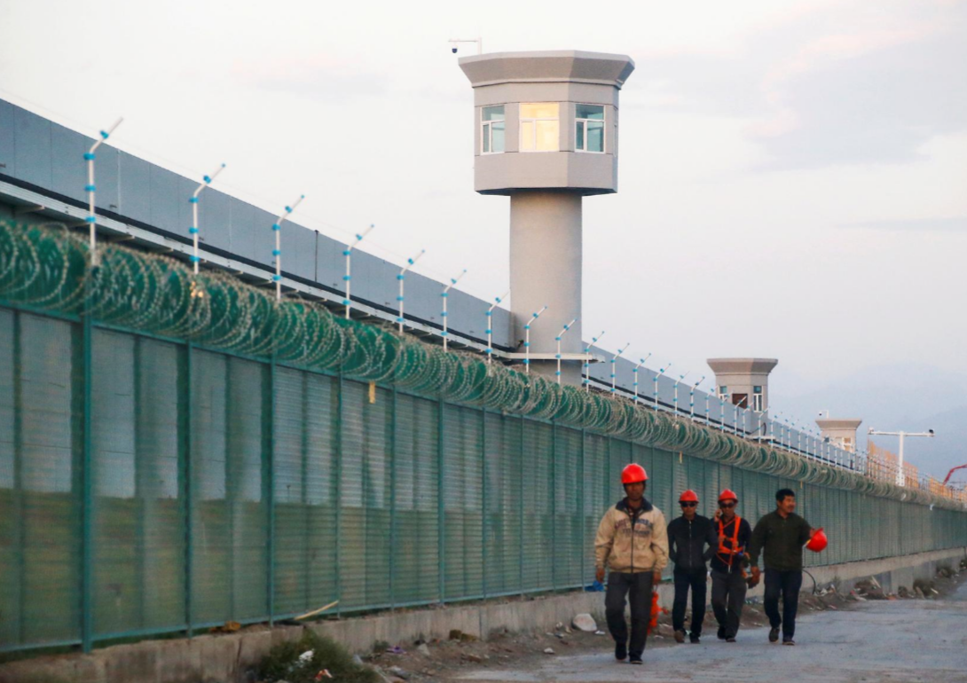 DOCUMENTED Image: Workers stroll by the edge fence of what is authoritatively known as a professional aptitudes instruction focus in Dabancheng in Xinjiang Uighur Autonomous Region, China September 4, 2018. REUTERS/Thomas Peter/File Photo