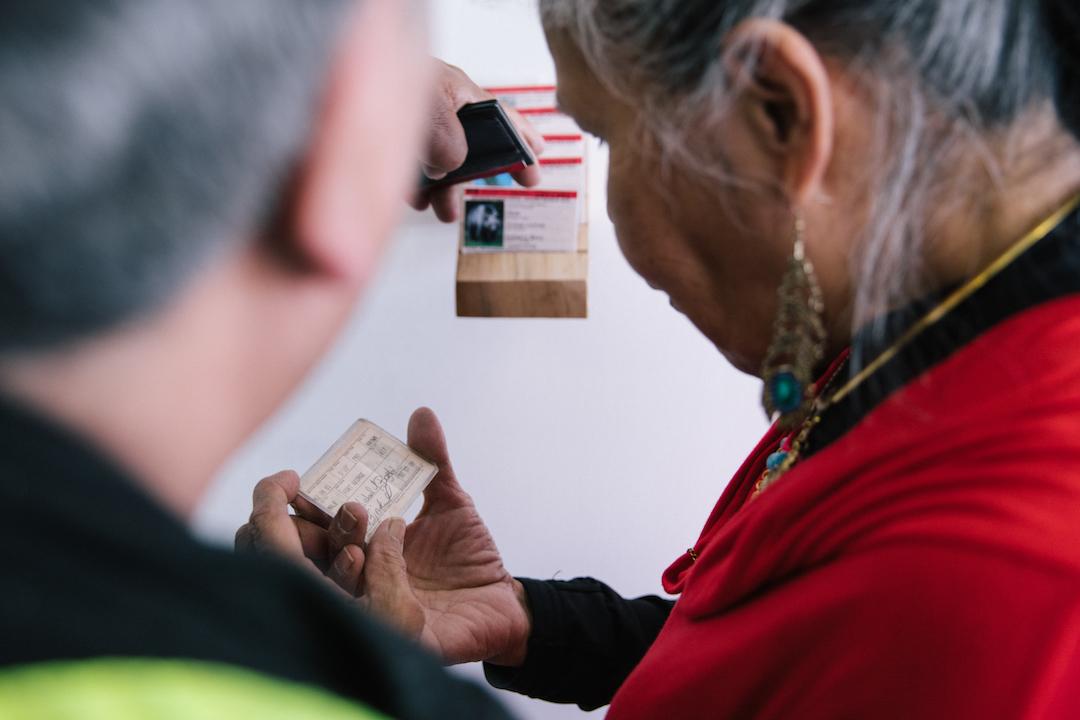 Jennifer Annaïs Pighin. Native Status Cards. 2017. Visitors examining the cards.Photo by Denis Gutiérrez-Ogrinc.
