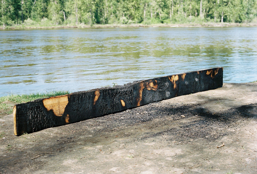 Andrew Maize.  FRASER (confluence) . 2017. Detail of Douglas Fir plank. Photo by Caitlin Chaisson.