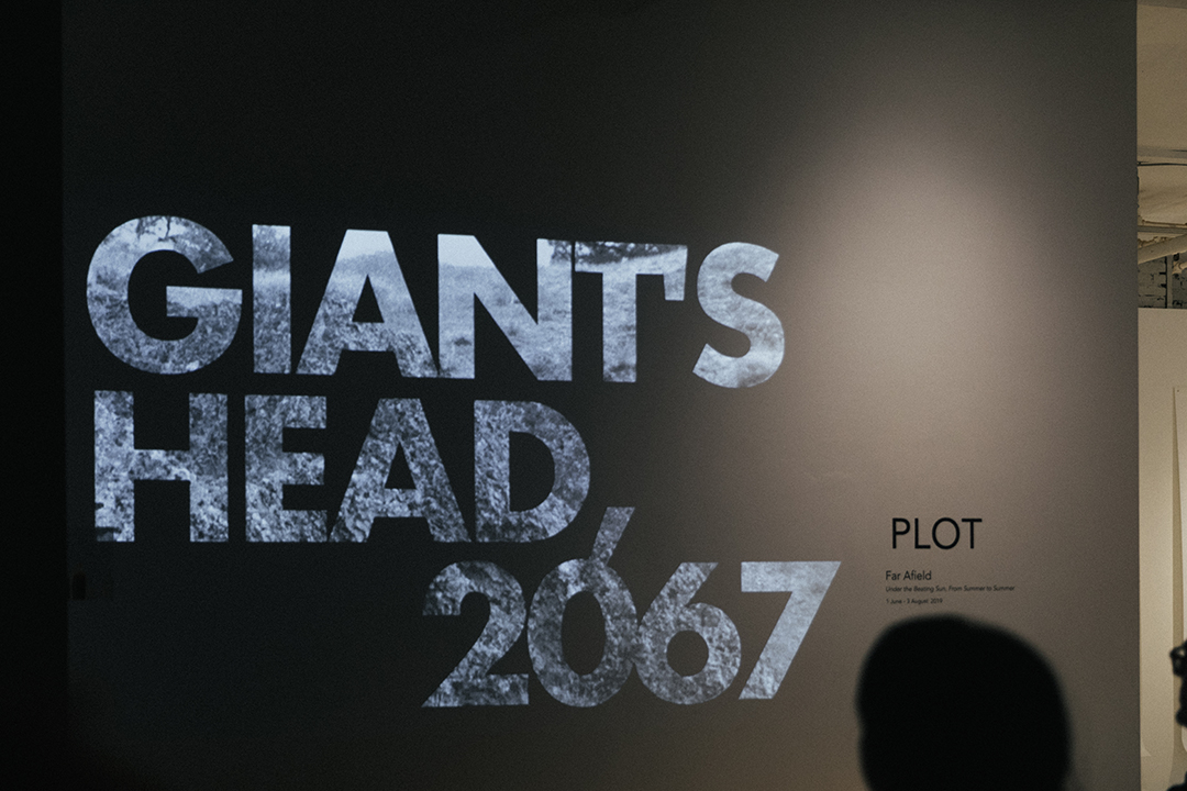 Curtis Grahauer.  Giant's Head, 2067 . 2019. 16 mm black and white film, sound. Music by Stephen Carl O'Shea. 5 min: 22 sec. Premiere screening in the PLOT space. July 18, 2019.
