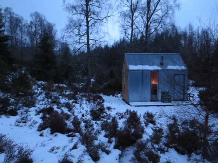 Inshriach Bothy in Inshriach Farm, Aviemore is tucked in a valley, the River Spey for soundtrack and the Cairngorms for a view. Even the frozen grass bows down to it in reverence.