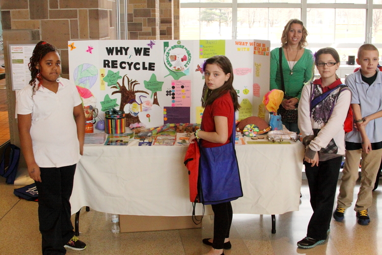Students from School 114 show off their recycling prowess.