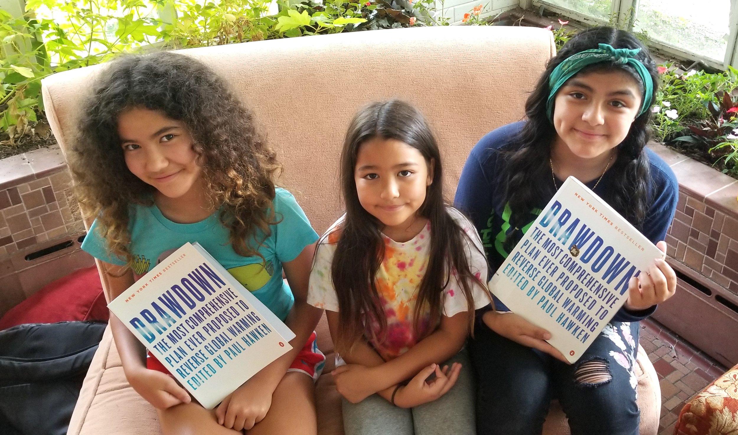 Hikari, Inori and Julianna study Drawdown at Climate Camp, July, 2018.