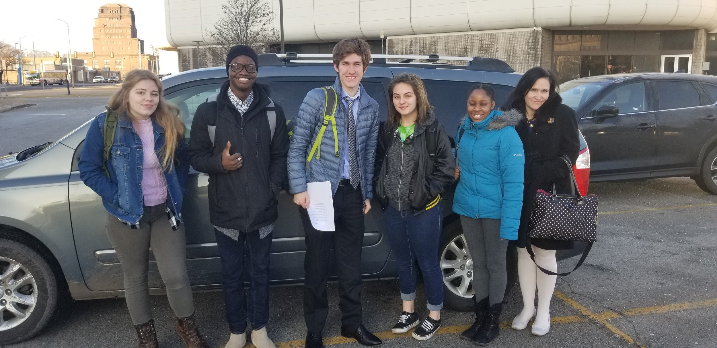 ECI volunteers and interns Cadyn, Stanley, Reed, Maddie and author Angel, with ECI Assistant Director Shannon Anderson.