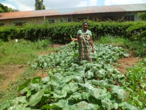 Alice working the family's small shamba (land for farming)