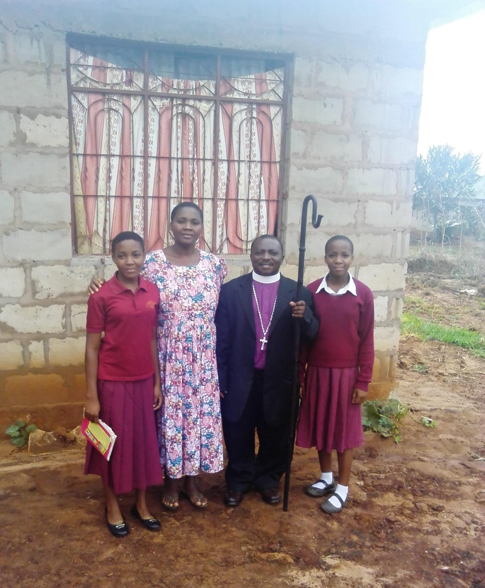 Sarah, right, with her father Bishop Frederick Chingwaba, mother Alice and sister Anna outside the family home in Morogoro in 2018.