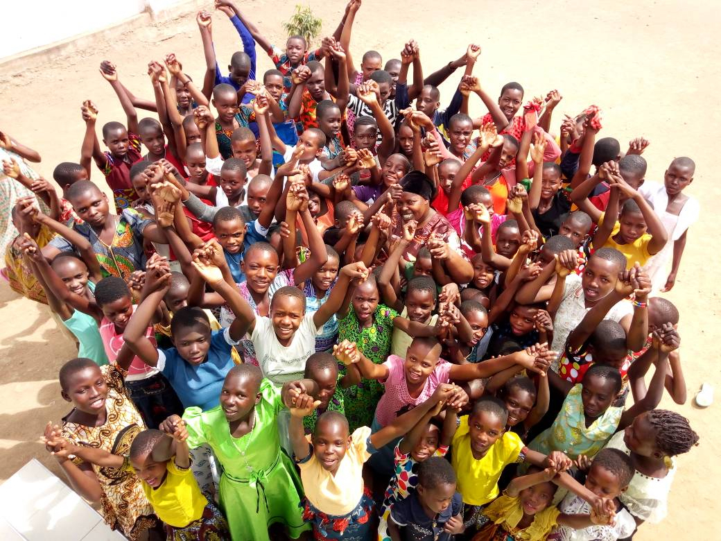 Rhobi Samwelly (center with black headscarf) has saved to date more than 600 girls from FGM and child marriage.