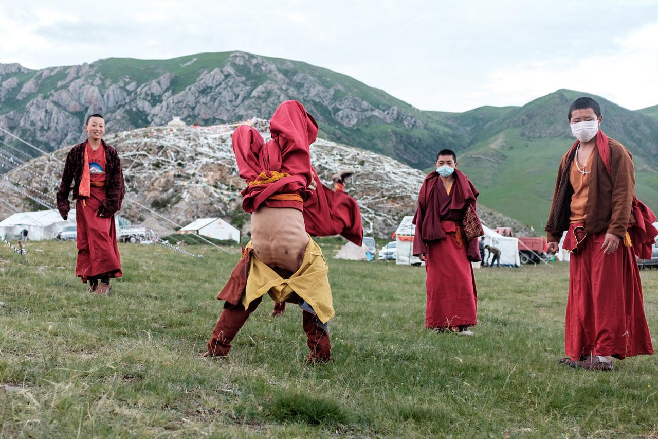 young tibetan monks doing handstands