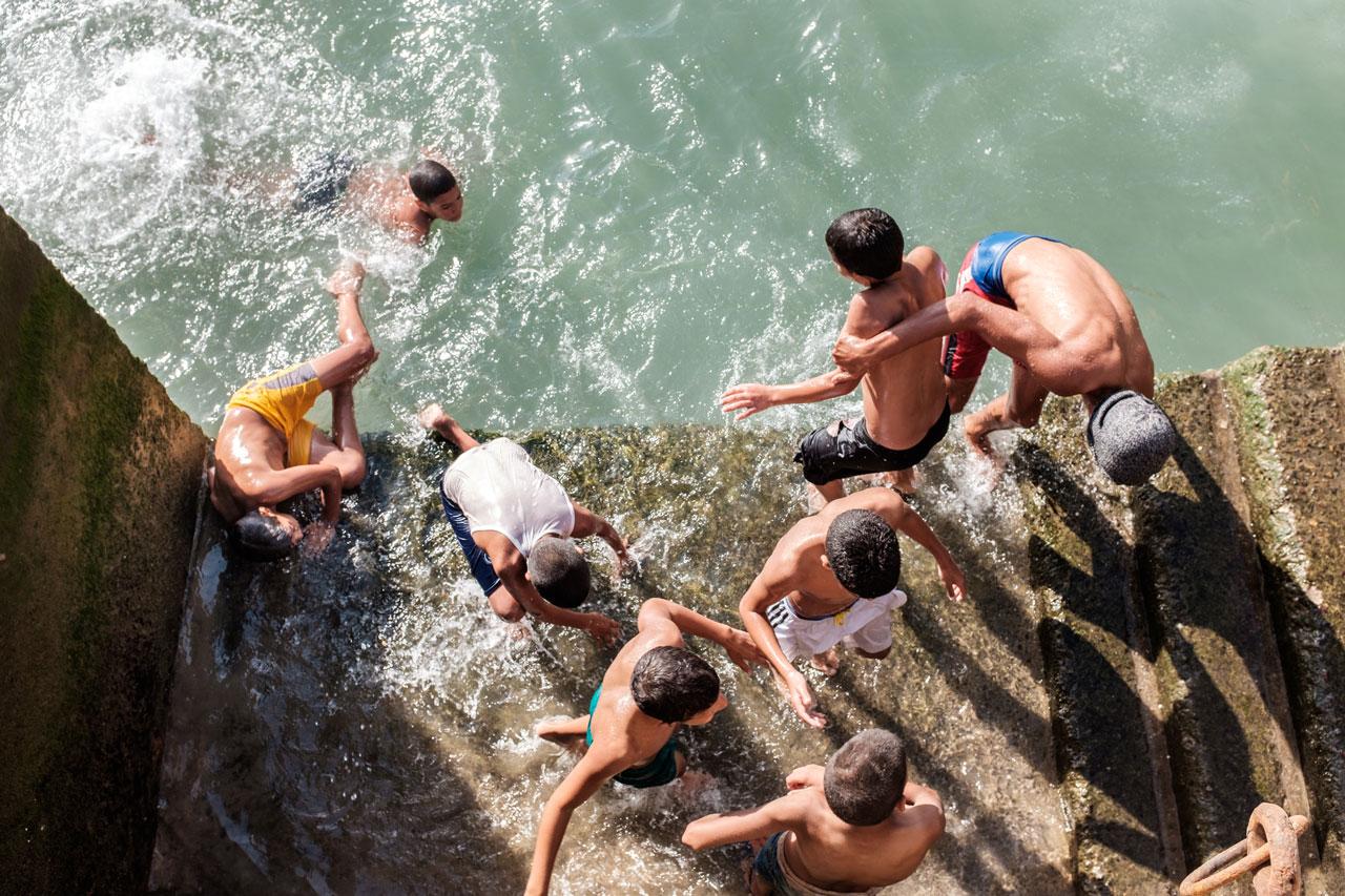 morocco essaouira kids playing in water