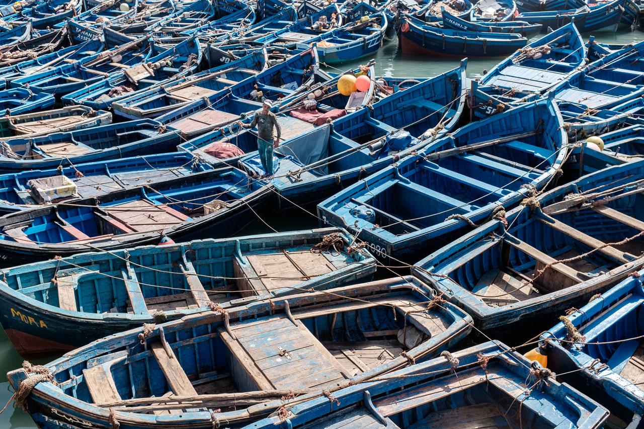 morocco essaouira man tying up boats