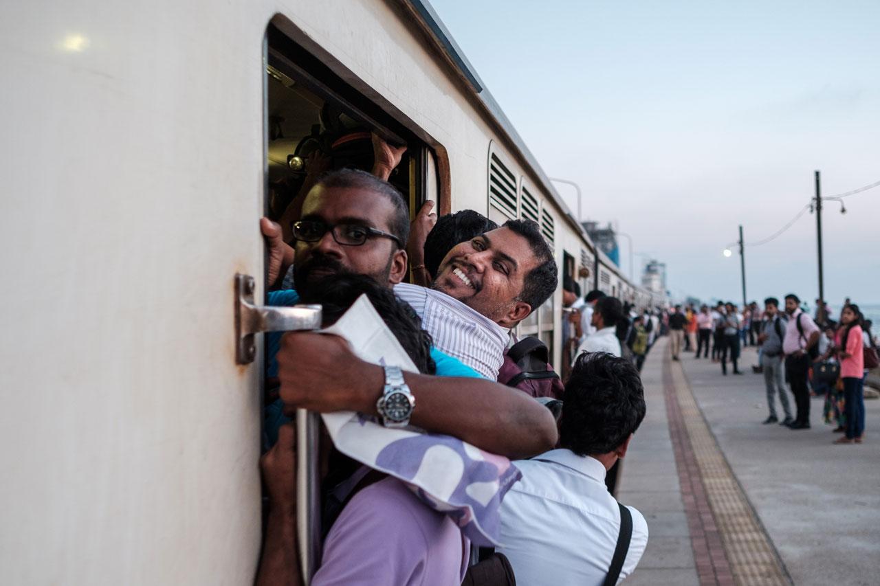 Copy of smiling man in full train in colombo sri lanka