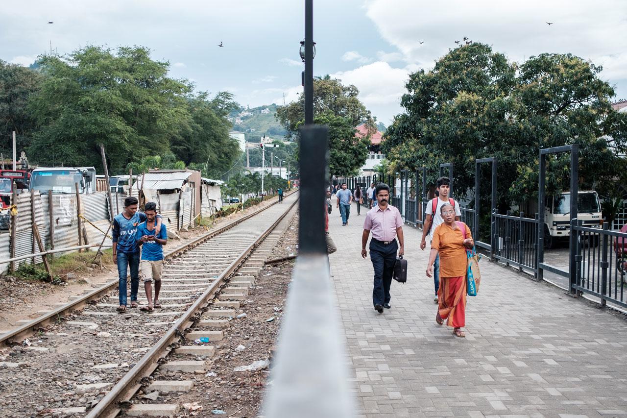 Copy of two friends walk on train tracks kandy sri lanka