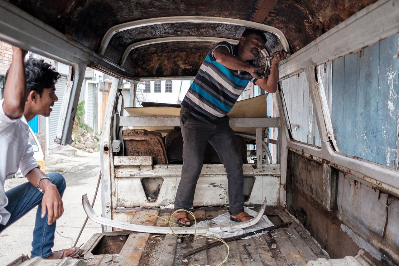 Copy of man dismantles a rusty old van haputale sri lanka