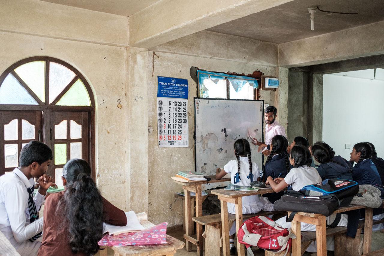 Copy of teacher with students in simple classroom haputale sri lanka