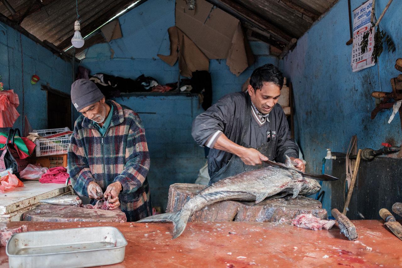 Copy of men cutting fish on market in nuwara eliya sri lanka