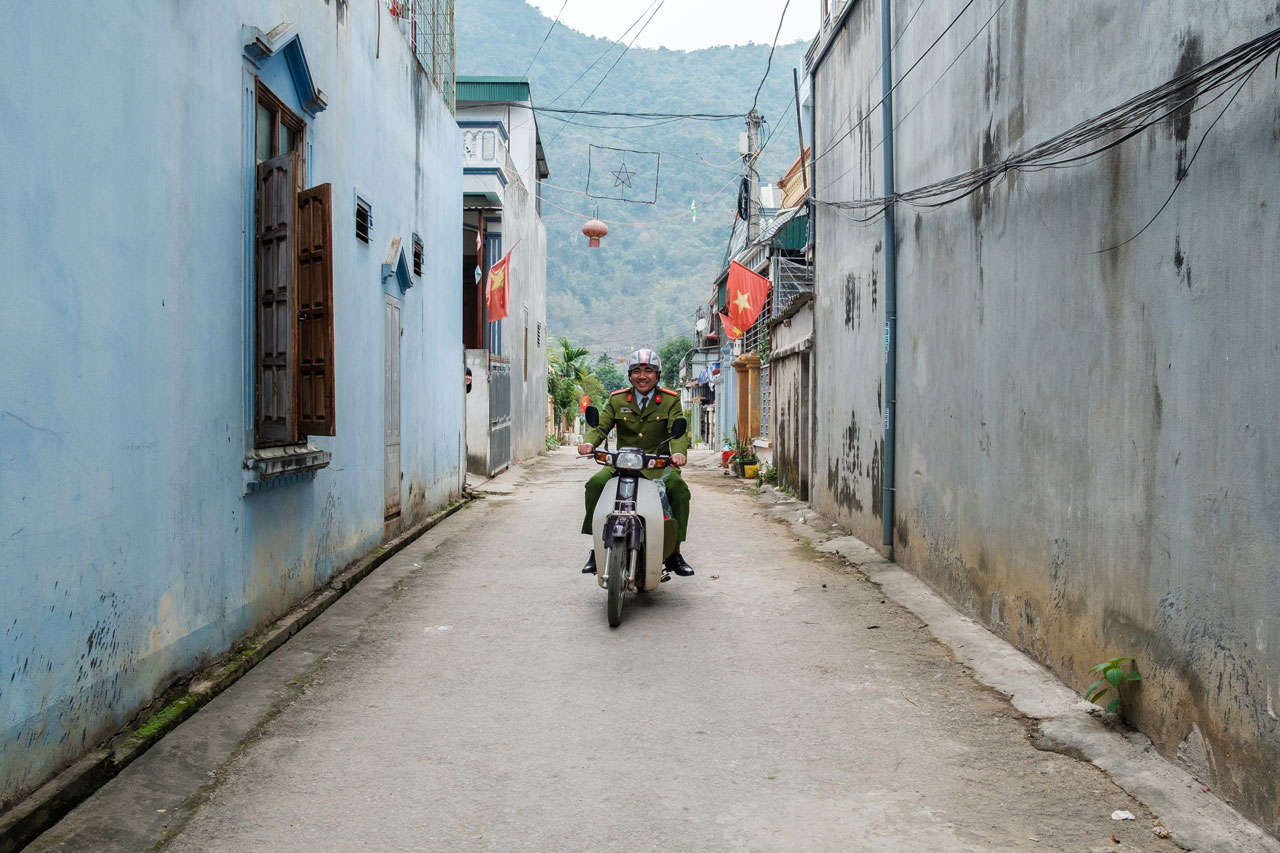 vietnamese policeman on motorbike in alley mai chau