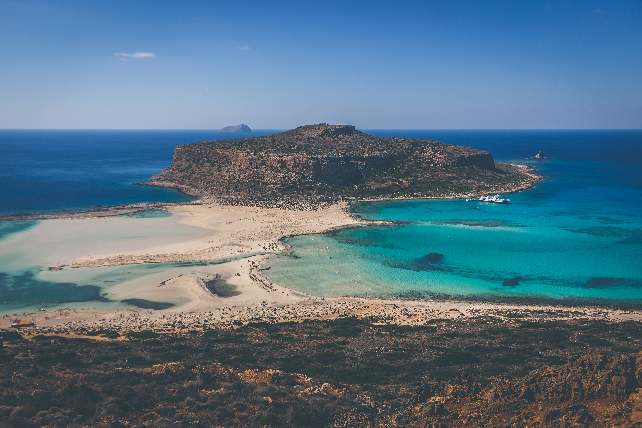 Yacht Cruise to Balos   • A cruise on a luxury 50 foot Ferreti motor yacht starts from Chania port and in 90 minutes, with a speed of 20-25 knots, takes you to the azure waters of Balos, a world known Cretan landmark and one of most photographed spots on the island.  • Reaching the islet of Gramvousa, you can walk up the small path leading to the top and enjoy the stunning view of the Venetian castle and the breathtaking outlook towards the west and the lagoon.  • You will swim in the crystal sea away from the crowds and when back on board you will enjoy a light lunch with wine and refreshments.  • Heading back towards Chania we will sail around the islet of Theodorou, a reserve for the rare Cretan wild goat, before our return in the old harbor in the evening.   Tour Time:  Approximately 9 hours   Group Size:  Available as a private charter for up to 8 people
