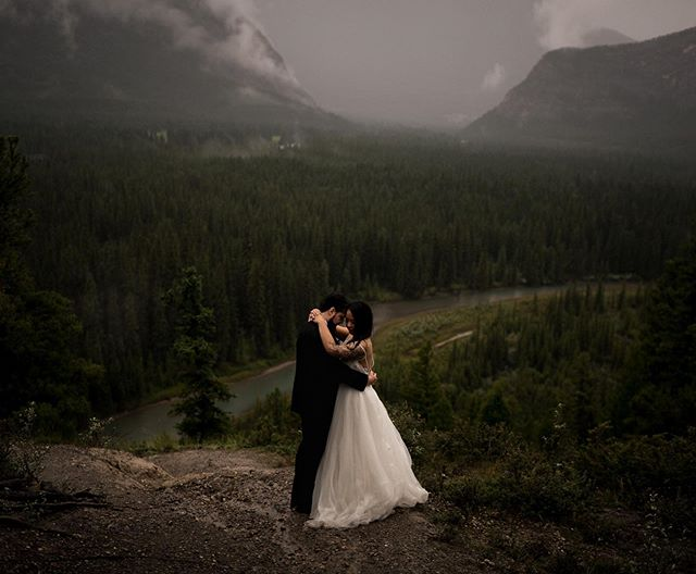 Well our formals on Saturday were certainly wet, we shot these in a torrential downpour. I love shitty moody weather so I was happy but what made it a million times better is when your bride and groom give zero fucks and just get soaked. Incredible couple, all smiles, zero complaints. Amazing wedding day in Banff with @joel.anderson99 & @_lily.le . . . . . . . . . . #elopementcollective #canmoreweddingphotographer #adventureweddingphotographer #lookslikefilm #loveandwildhearts #forthewildlyinlove #chasinglight #explorecanada #authenticlovemag #couplesgoals #banffwedding #photobugcommunity #destinationwedding #calgaryweddingphotographer #radlovestories #mountainelopement #dirtybootsandmessyhair #adventurouswedding #elopement #adventurouslovestories #junebugweddings #huffpostwedding #moodyports #rockymtnbride #yourockphotographers #banffweddingphotographer #forthewildlovers #lookslikefilmweddings #youngandwildweddings #destinationweddingphotographer