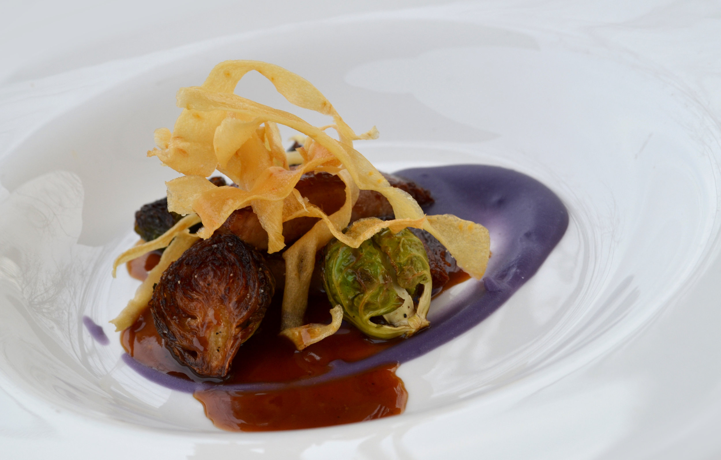 The finished Braised Kurobuta Pork with Okinawan Sweet Potatoes and Brussels Sprouts