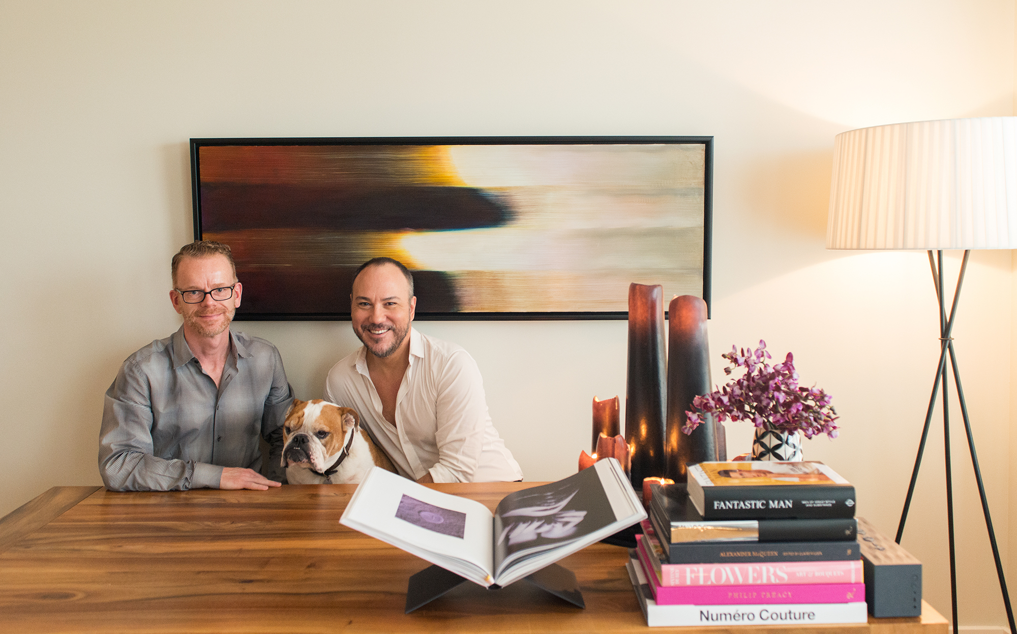 Photography by  Shane Sasaki , husband Hermann, bulldog Sparky, and Alphonse in their dining room.