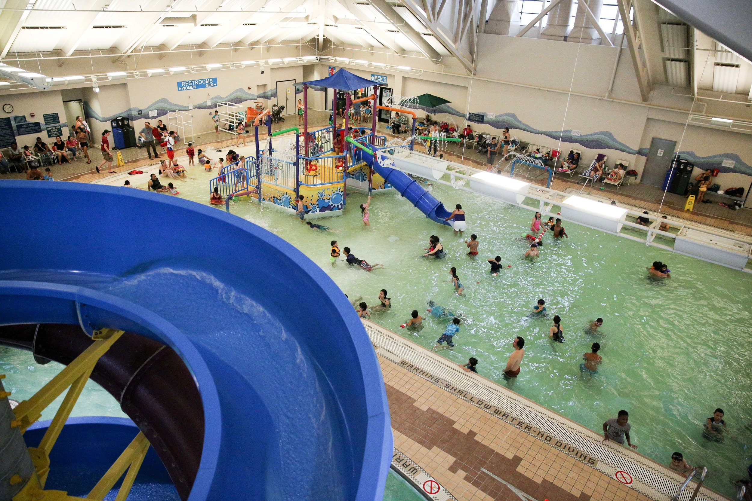 Children play on the activity pool structure at the Silliman Family AquaticCenter in Newark on Friday, Aug. 4, 2017. The structure is set to bereplaced this winter as part of a larger maintenance project. (Photo byJoseph Geha/The Argus)