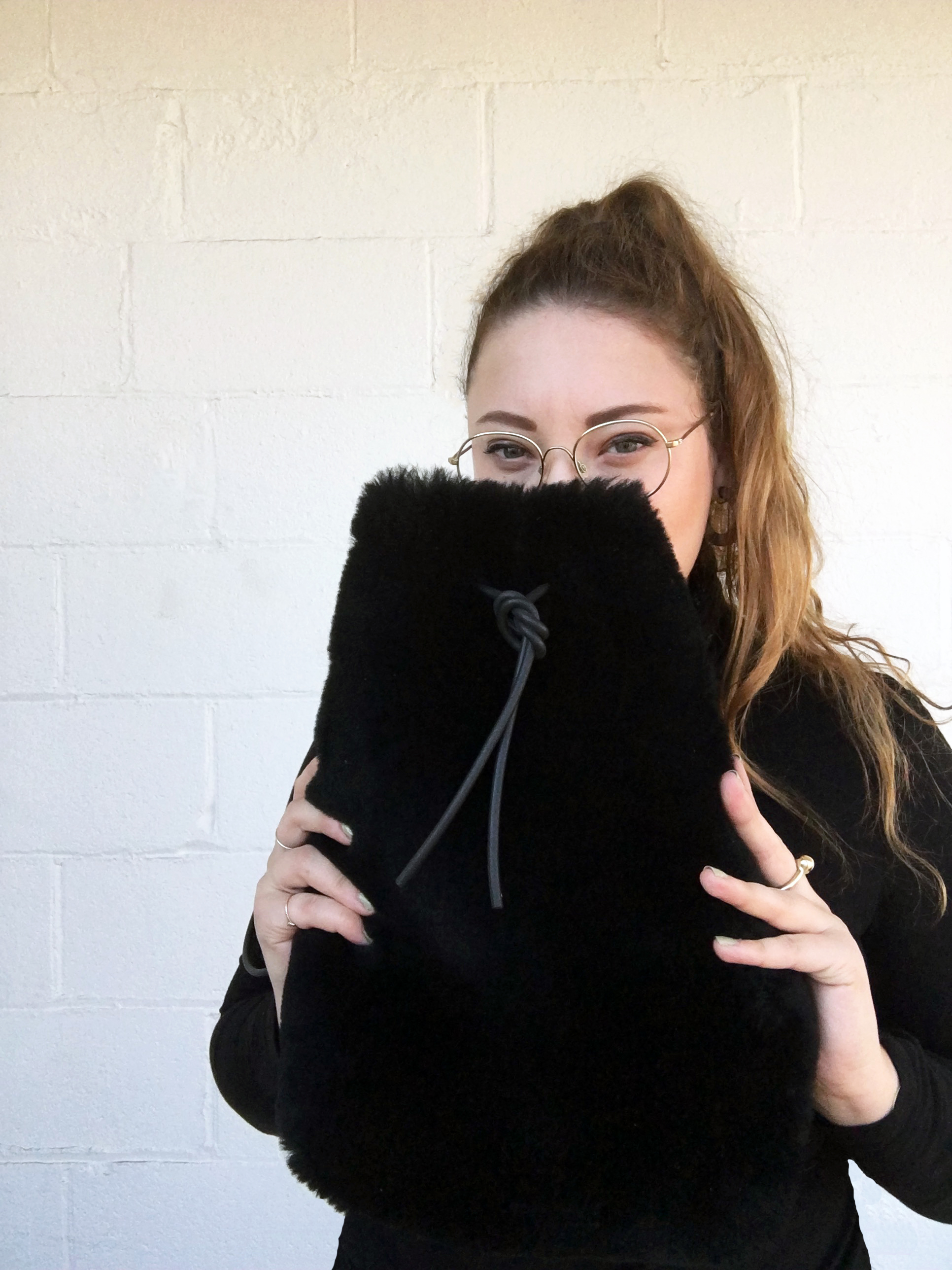 The designer, Hannah Emile with one of her bags.