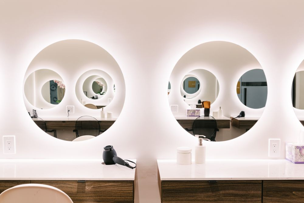 The bathroom equipped with blow dryers and other amentities.