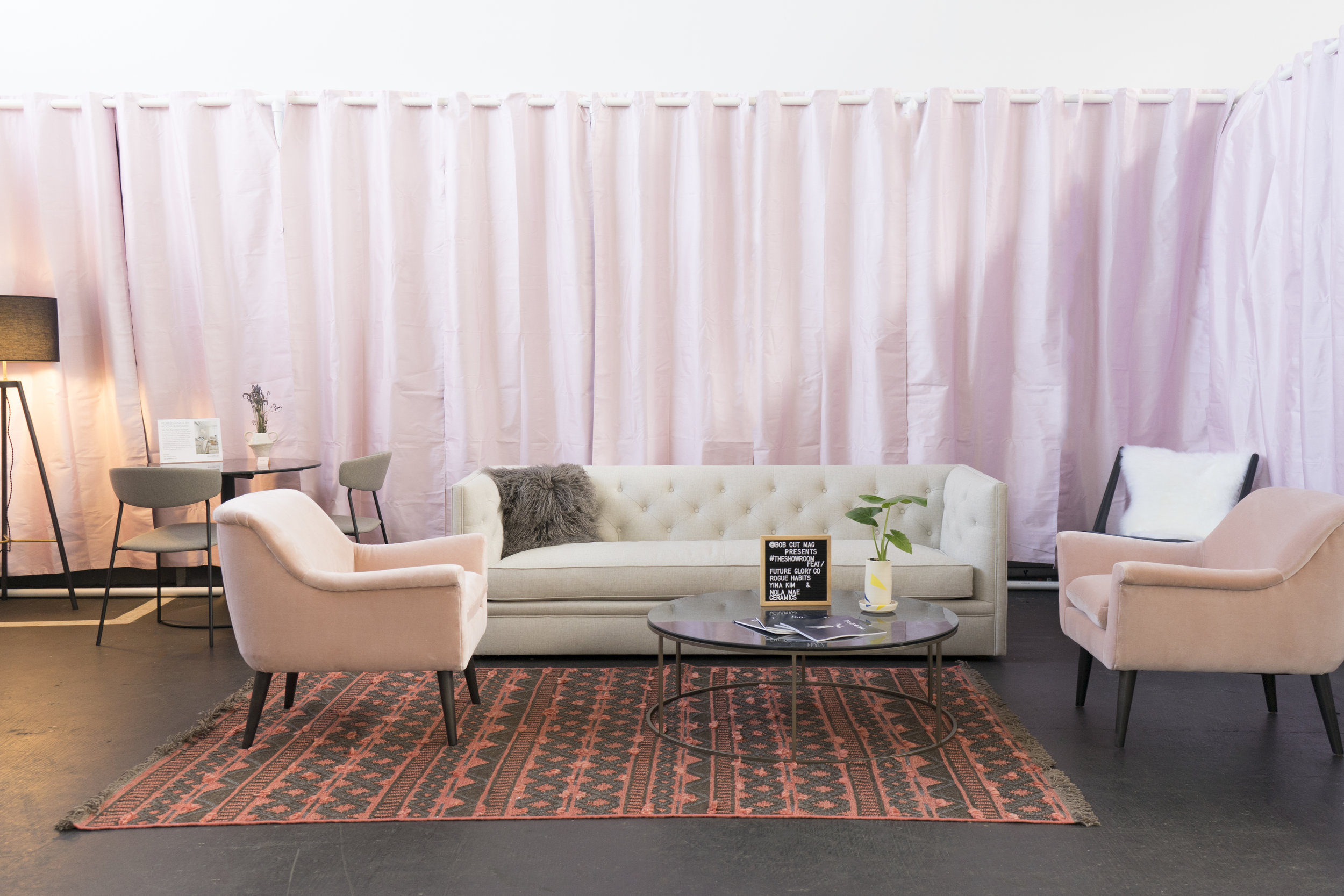 Featuring the  Embers Rugs ,  Tyne Round Coffee Table , Nola Mae Ceramics, Yina Kim,  the Pepper Pillow Ensemble ,  Murphy Chair & Ottoman ,  Oskar Lounge Chair , and the  Macalester Sofa .