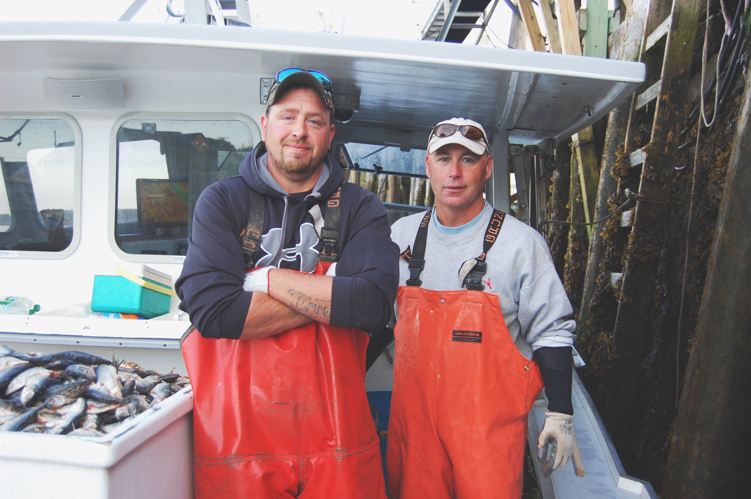 Two of Luke's east coast fisherman garnering their daily catch on the water, photo courtesy of Luke's Lobsters.