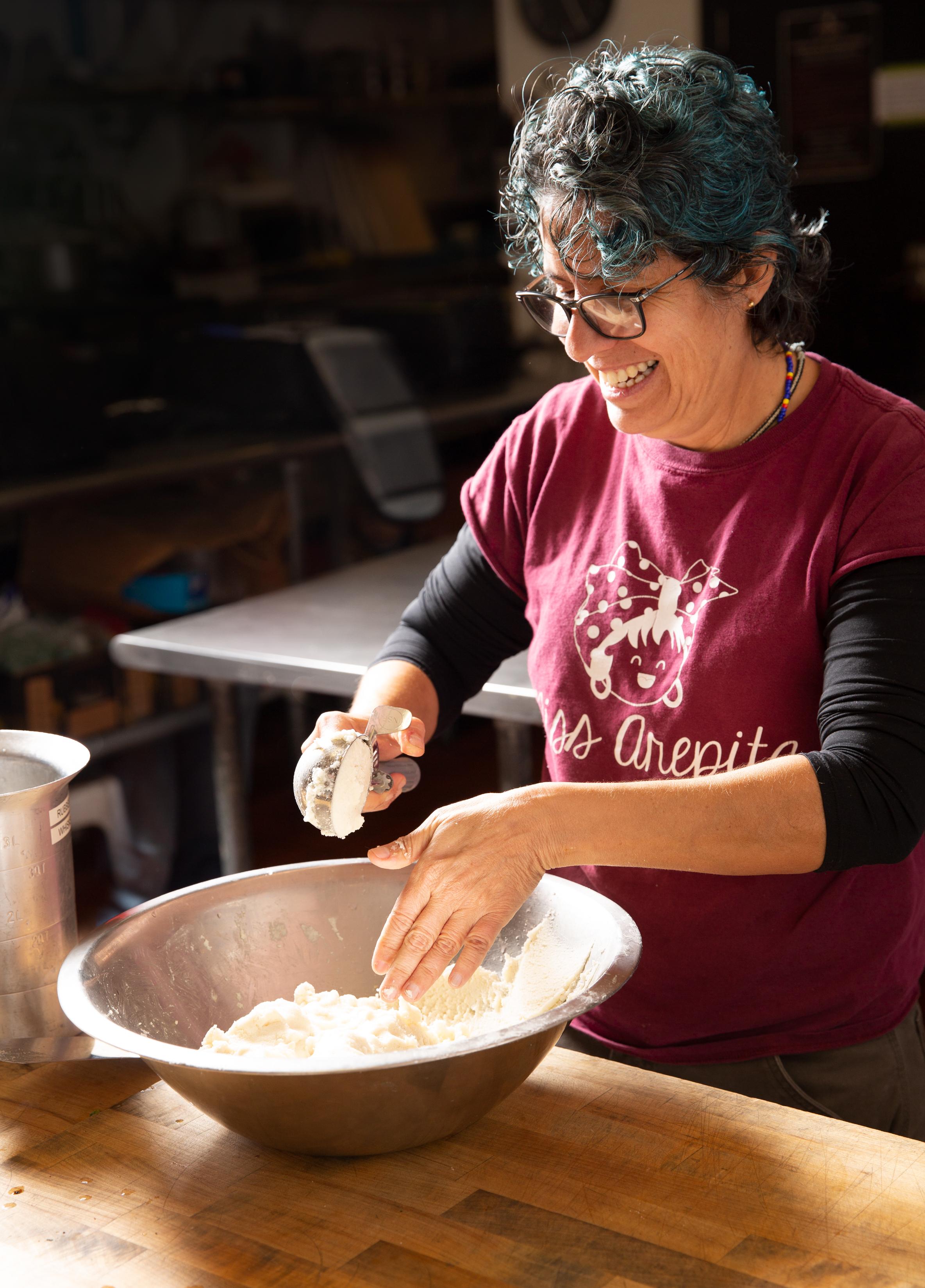 Carolina Abolio in her kitchen preparing for a dinner rush.