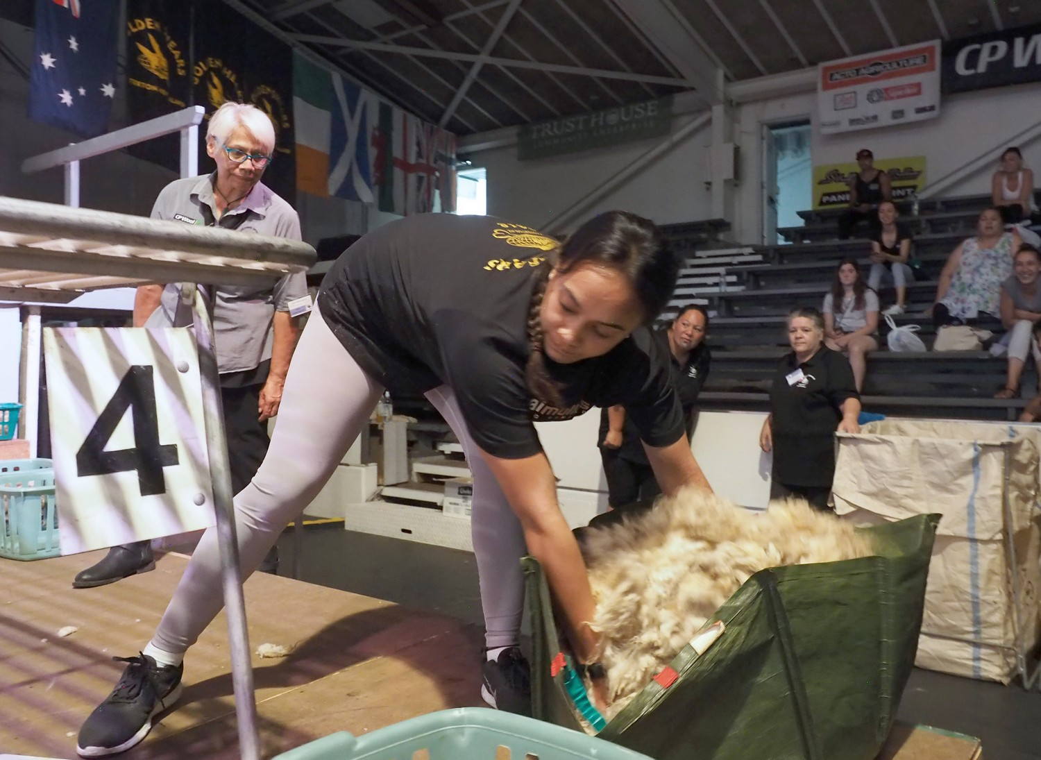 """Heaven Kemp, of Gisborne, on her way to her """"shock"""" win in the Novice woolhandling final on the opening day of the 58thGolden Shears in Masterton today. PHOTO/Pete Nikolaison, Golden Shears Media Group."""