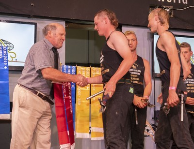 Golden Shears life member Selwyn Tomlin about to present winning ribbons to Pukemiro Station's steam of Connor McIntyre and Jesse McIntyre on the opening day of the Golden Shears in Masterton today.