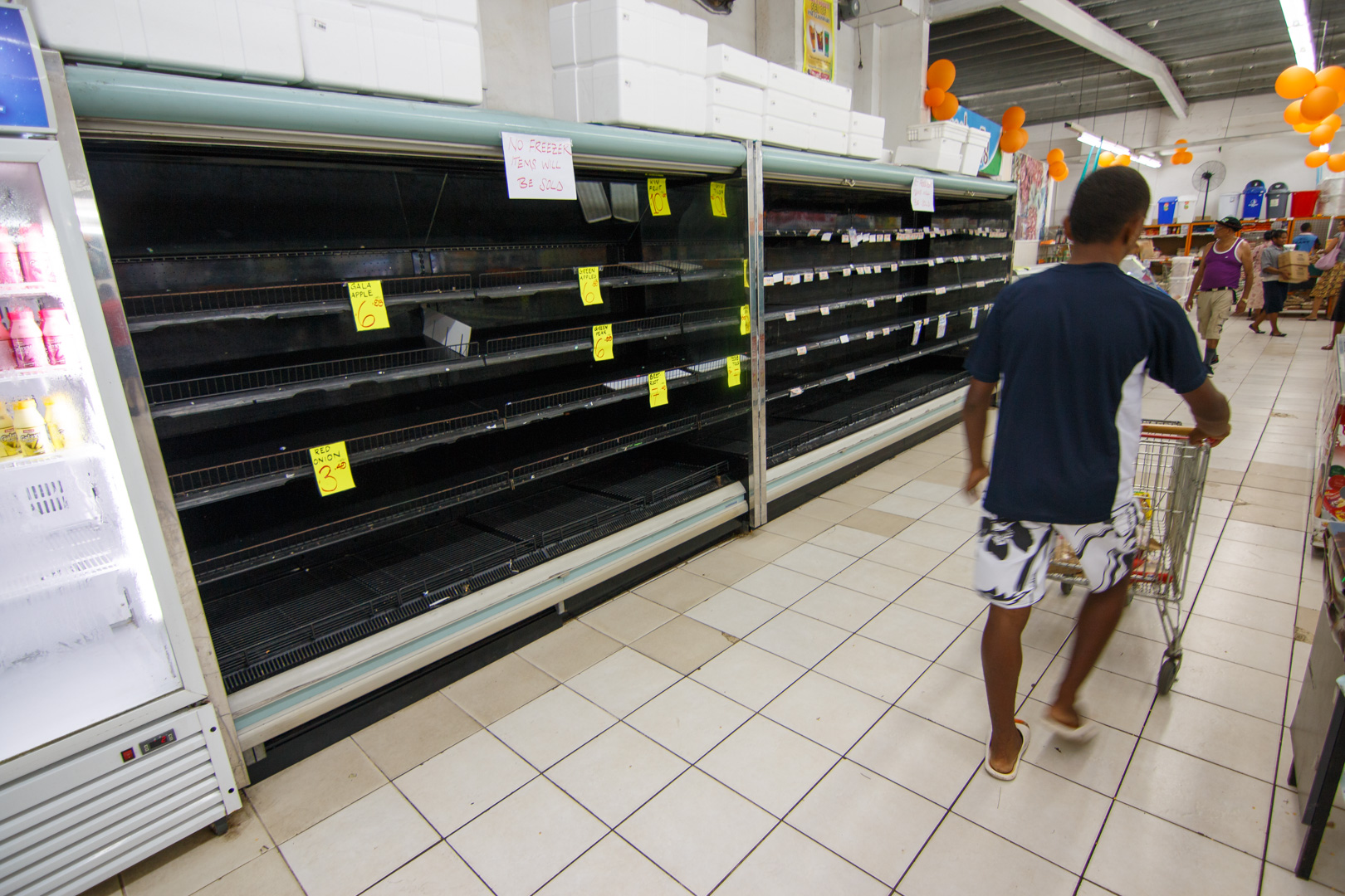 The refrigerated section of a supermarket lays empty of products after power losses due to Cyclone Winston in Fiji's capital Suva, February 22, 2016.
