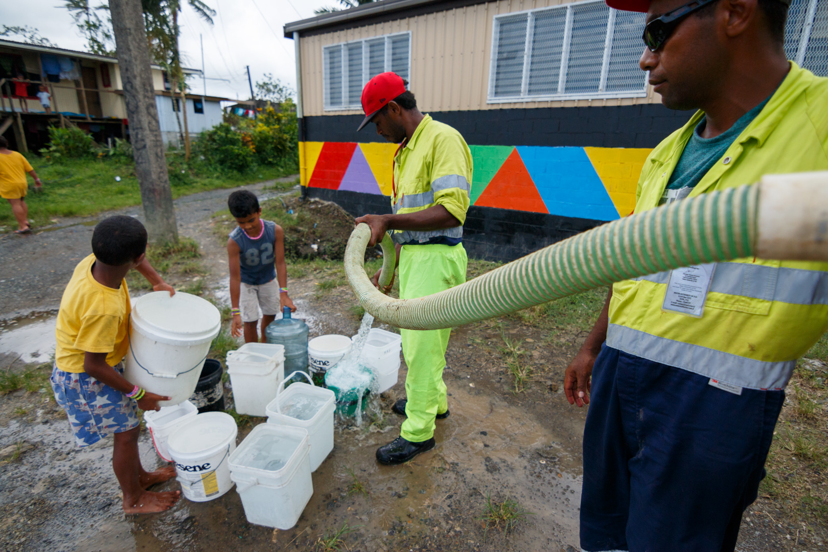 Workers from Suva's City Council fills residents' buckets with fresh water after power outages caused by Cyclone Winston stopped the pumps from working throughout Fiji's capital Suva, February 23, 2016.