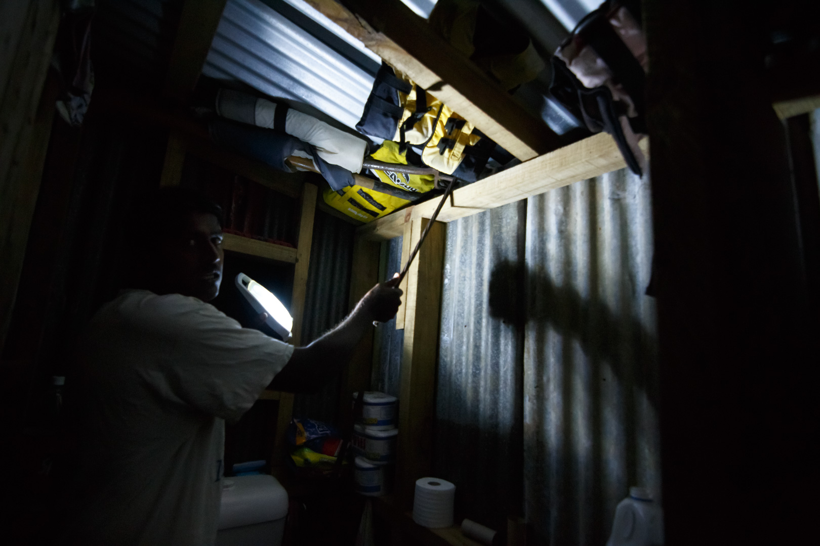 A resident from Nausori, Fiji, points to the emergency repairs he performed on his corrugated iron roof when it became dislodged and began to leak water after Cyclone Winston swept through the area on February 20, 2016.