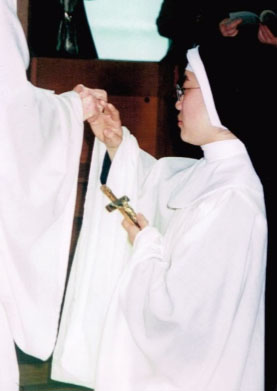 A Sister Receiving Cowl,Ring & Crucifix