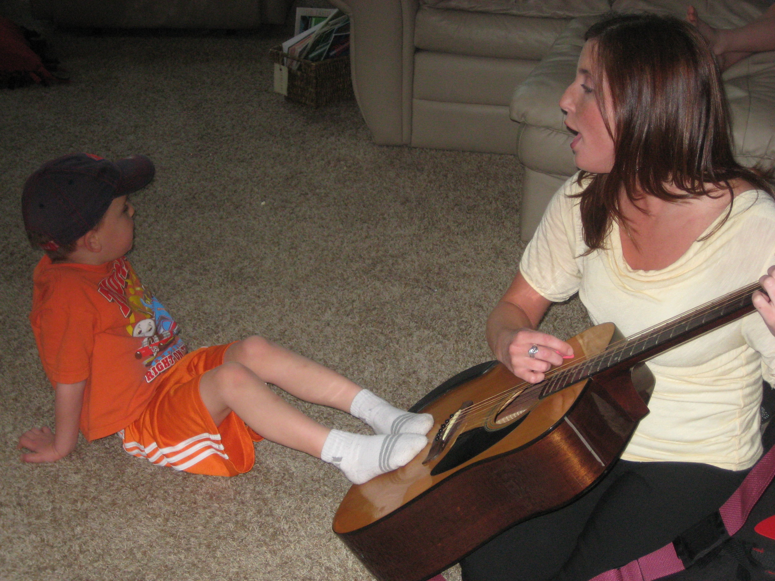 Extrasensory Stimulation - Sensory Stimulation: Feet on the guitar allows the child to hear and feel the music.